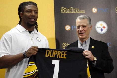 "Alvin ""Bud"" Dupree, a linebacker out of Kentucky, left, poses with a team jersey beside Pittsburgh Steelers President Art Rooney II as he is introduced at a news conference, Friday, May 1, 2015, in Pittsburgh, Depree was chosen by the Pittsburgh Steelers in the first round, 22nd overall, in the NFL football draft on Thursday. (AP Photo/Keith Srakocic)"