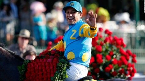 Victor Espinoza waves to fans after winning the 2015 Kentucky Derby aboard American Pharoah (Rob Carr/Getty Images)