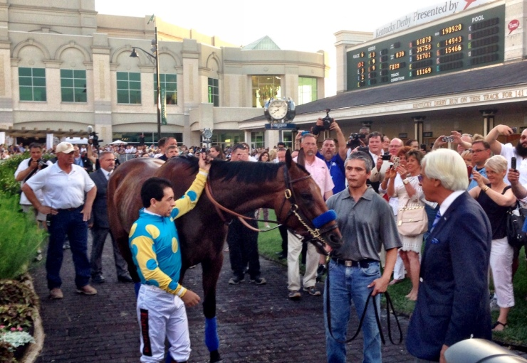 Jockey Victor Espinoza with American Pharoah in the Churchill Downs paddock as trainer Bob Baffert gets a good look at his Triple Crown winner (John Cox photo)