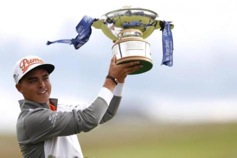 Rickie Fowler holding aloft his Scottish Open trophy. PHOTO: REUTERS