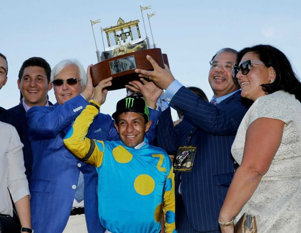 Triple Crown winner American Pharoah's trainer Bob Baffert, center left, jockey Victor Espinoza, center, and owner Ahmed Zayat, second right, and his wife, Joanne Zayat, right, hold up the winner's trophy after American Pharoah won the Haskell Invitational horse race at Monmouth Park in Oceanport, N.J., Sunday, Aug. 2, 2015. Keen Ice was second. Photo: Mel Evans, AP