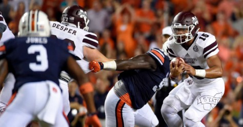 Sep 26, 2015; Auburn, AL, USA; Mississippi State Bulldogs quarterback Dak Prescott (15) scrambles for yardage against the Auburn Tigers during the first quarter at Jordan Hare Stadium. Mandatory Credit: John David Mercer-USA TODAY Sports