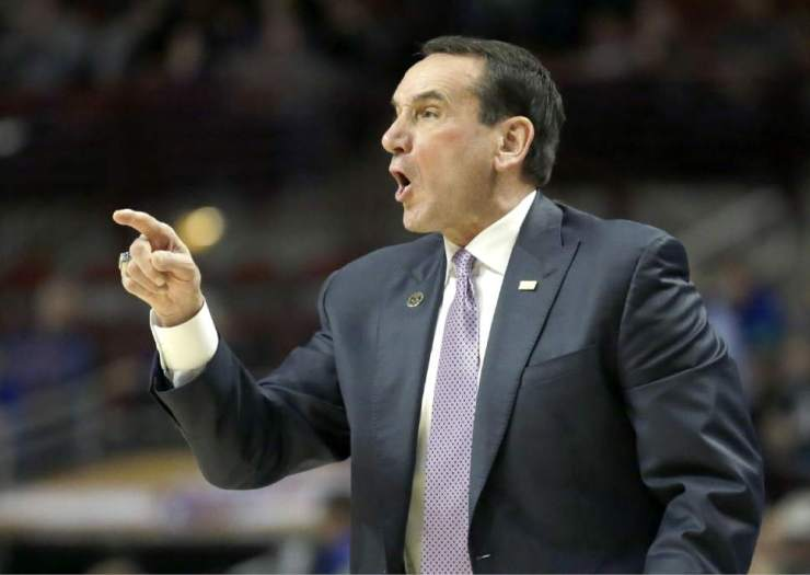 Duke head coach Mike Krzyzewski directs his team during the first half of an NCAA basketball game against the Kentucky Tuesday, Nov. 17, 2015, in Chicago. (AP Photo/Nam Y. Huh)